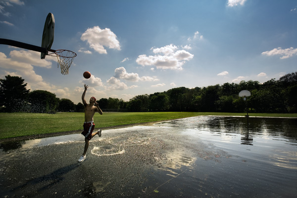 Cousin Mike on a Flooded Basketball Court